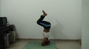 Lift your legs - inhale - sirsasana