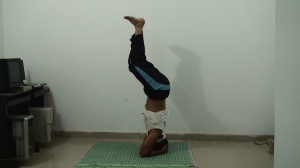 Lift your legs further - inhale - sirsasana