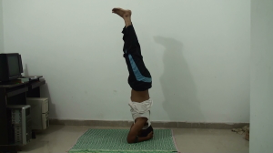 Lift your legs further straigther - inhale - sirsasana