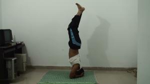 Fold your knees slowly Sirsasana