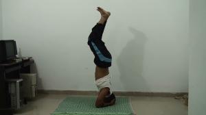 Fold your knees slowly further Sirsasana